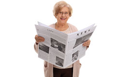 Mature woman holding a newspaper Royalty Free Stock Photography