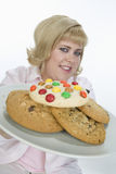 Mature Woman Holding Plate Of Cookies Royalty Free Stock Photo