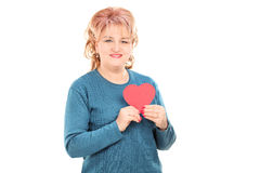 Mature woman holding a red heart Royalty Free Stock Photo