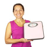 Mature woman holding scale Stock Photography