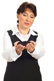 Mature woman holding small plant Stock Photos
