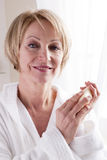 Mature Woman Holding Soap. Close-up Royalty Free Stock Image