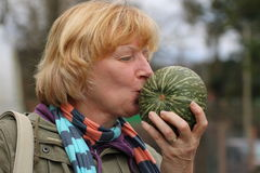 Mature woman holding squash Stock Image