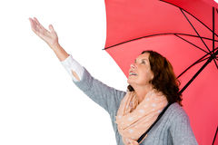 Mature woman holding umbrella Royalty Free Stock Photo
