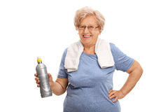 Mature woman holding a water bottle Royalty Free Stock Photos
