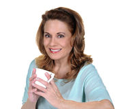 Mature Woman holding White Cup stock images