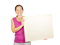 Mature woman holds blank canvas Royalty Free Stock Photo