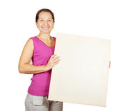 Mature woman holds blank canvas Stock Photos