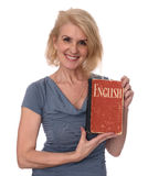 Mature woman holds an english textbook. Isolated on white Royalty Free Stock Image
