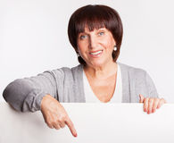 Mature woman holds a placard royalty free stock images