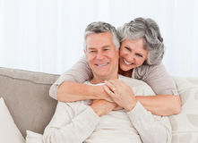 Mature woman hugging her husband Royalty Free Stock Photo