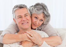 Mature woman hugging her husband Stock Image