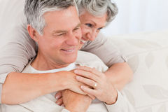 Mature woman hugging her husband Royalty Free Stock Image
