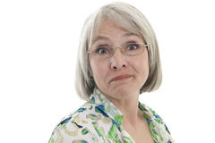 Mature woman with humorous expression. Mature, attractive Caucasian woman with a humorous expression Stock Photography