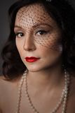 Mature Woman In Pearl Necklace And A Black Veil Stock Photography