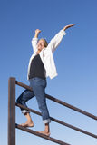 Mature Woman In Winner Pose Outdoor Royalty Free Stock Photography