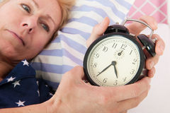 Mature woman with insomnia Stock Images
