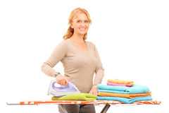 Mature woman ironing clothes Royalty Free Stock Photo