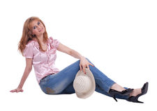 Mature woman in jeans with straw hat Royalty Free Stock Image