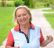 Mature woman doing sport in the park royalty free stock photo