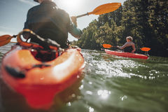 Mature woman kayaking in lake on a sunny day Stock Image