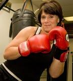 Mature Woman kickboxing stock photo