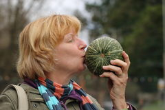 Mature woman kissing vegetable Royalty Free Stock Images