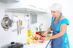 Mature woman on the kitchen Stock Photography
