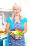 Mature woman on the kitchen Royalty Free Stock Photo