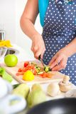Mature woman on the kitchen Royalty Free Stock Images
