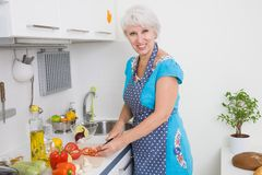 Mature woman on the kitchen Royalty Free Stock Photos