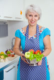 Mature woman on the kitchen Royalty Free Stock Photography