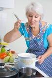 Mature woman on the kitchen Stock Photos