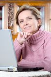 Mature woman with laptop Royalty Free Stock Photo