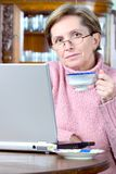 Mature woman and laptop Royalty Free Stock Photo