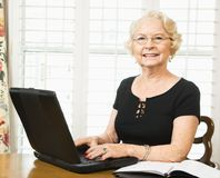 Mature woman with laptop. Royalty Free Stock Image