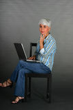 MAture woman with laptop Stock Images