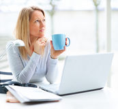 Mature woman with a laptop Stock Photo