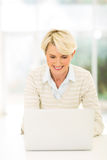 Mature woman laptop Stock Photo