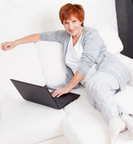 Mature woman with laptop Stock Photo