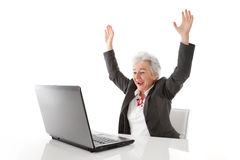 Mature woman with laptop is happy - isolated on white Royalty Free Stock Photo