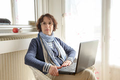 A mature woman with a laptop Royalty Free Stock Image