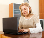 Mature woman  with laptop Royalty Free Stock Photography