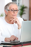 Mature woman laptop Stock Images