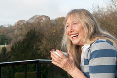 Mature woman laughing Stock Image