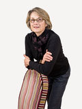Mature Woman Leaning on Chair Stock Photography