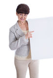 Mature woman leaning on white banner. Portrait against of white background Royalty Free Stock Image
