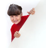 Mature woman leaning on white banner smiling against of white background Stock Photo