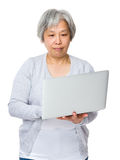Mature woman learn to use laptop Royalty Free Stock Images