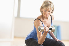 Mature Woman Lifting Dumbbell At Home Royalty Free Stock Photo
